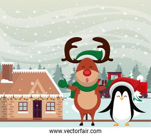 christmas snowscape scene with reindeer and penguin
