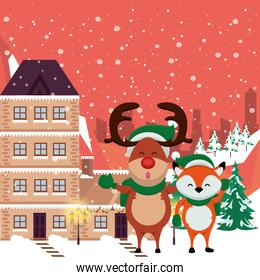 christmas snowscape scene with reindeer and fox