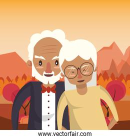 cute grandparents couple lovers in the sunset landscape