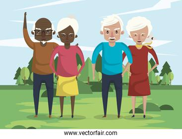 group of interracial grandparents couples in the field