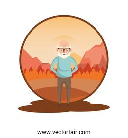cute grandfather in the sunset landscape
