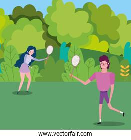 young couple with tennis rackets in the park cartoon