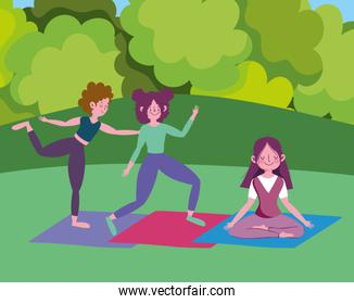group happy girls practicing yoga on mats in the park