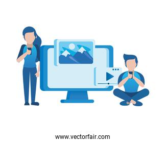 young couple using smartphone and desktop