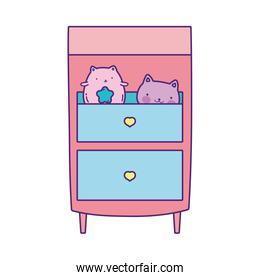wooden drawers with toys cats on white background