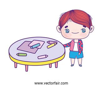 cute little boy cartoon with table and crayons
