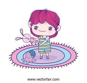 cute little boy with toy rabbit and octopus cartoon on carpet