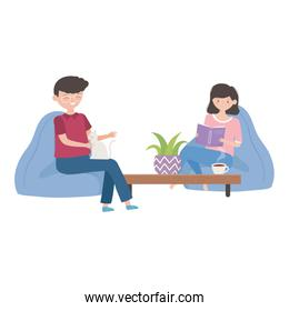 smiling man sitting with cat and girl reading book in