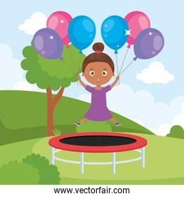little girl afro in trampoline jump with balloons helium in park landscape