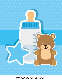 baby bottle milk with teddy bear and star
