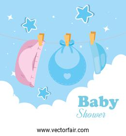 baby shower card with clothes hanging and decoration
