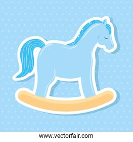 wooden horse toy in blue background