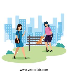 women with dog mascot in park landscape