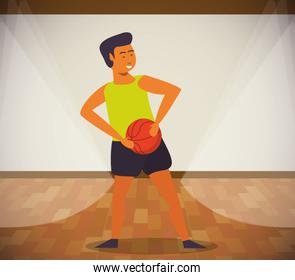 young man athlete playing basketball with balloon