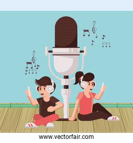 couple announcers with radio microphone and earphones