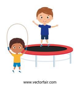 cute little boys with trampoline jump and rope jump