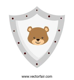face of cute teddy bear in shield isolated icon