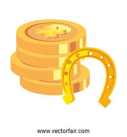 stack of coins with clovers and horseshoe