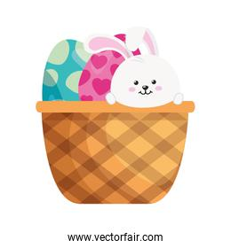 rabbit and set of cute eggs easter decorated in basket wicker