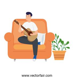 young man stay at home playing guitar in sofa