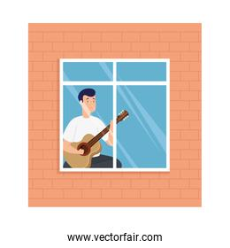 young man stay at home playing guitar in window