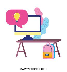education online, computer on desk backpack class