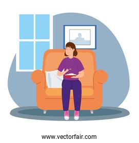 young woman eating in sofa