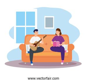 young couple reading and playing guitar