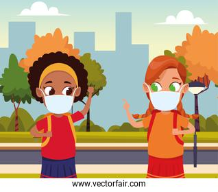 interracial girls using face masks for covid19 in the park