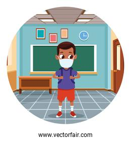 little afro boy using face mask for covid19 in the classroom