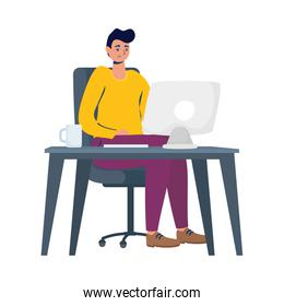 young man working with desktop in desk