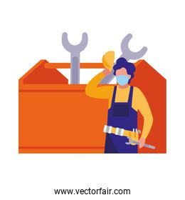 man working with tools and mask