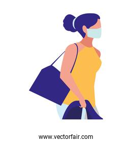 woman walking in the city wearing face mask