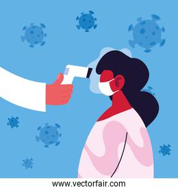 doctor measures the temperature of a woman in a medical mask, coronavirus prevention
