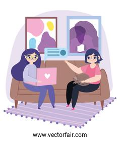 working remotely, young women with laptop and girl with cat on sofa