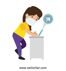woman using face mask searching information in laptop of covid 19