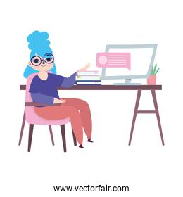 working remotely, girl with computer books on desk
