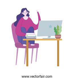 working remotely, young woman in desk with computer with plant decoration