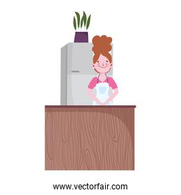 people cooking, woman with fridge potted plant and counter in the kitchen