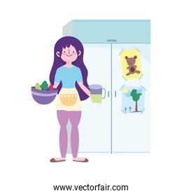 people cooking, girl with bowl and juice jar in the kitchen