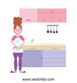 people cooking, girl with fruits slices on cutting board in kitchen
