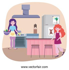 people cooking, girls with vegetable in bowl and juice jar in the kitchen
