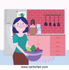 people cooking, woman with vegetable bowl knives cutlery in the kitchen