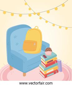 sweet home armchair backpack cupcake on stack of books and lights
