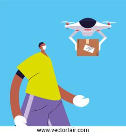 man with drone carries cardboard box