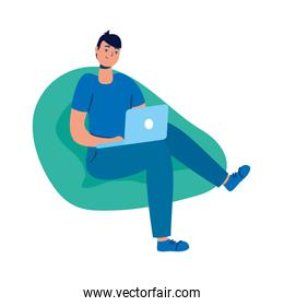 young man using laptop seated in sofa