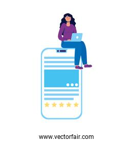 young woman using laptop seated in smartphone