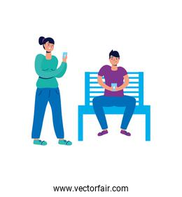 young couple using smartphone in park chair
