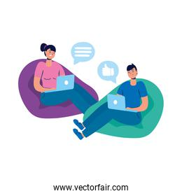 young couple using laptop with social media tech seated in sofa