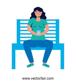 young woman using smartphone in park chair